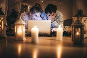 Couple enjoying a movie at night