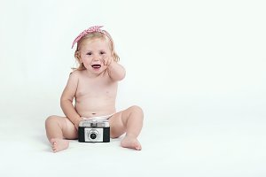 baby girl with retro camera