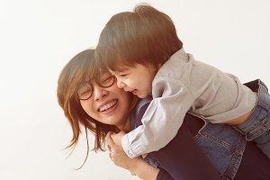 Japanese mother hugs her son