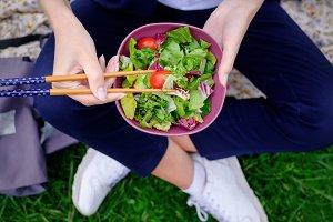 girl eats fresh salad
