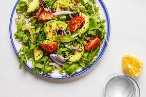 Healthy arugula, avocado salad