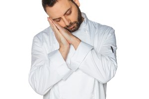 Young Chef sleeping in white uniform