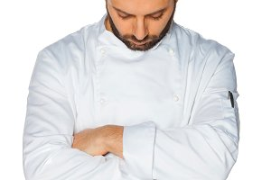Young chef  sleeping on white backgr