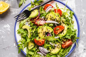 Healthy arugula, avocado salad