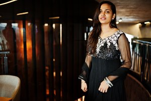 Pretty indian girl in black saree dr
