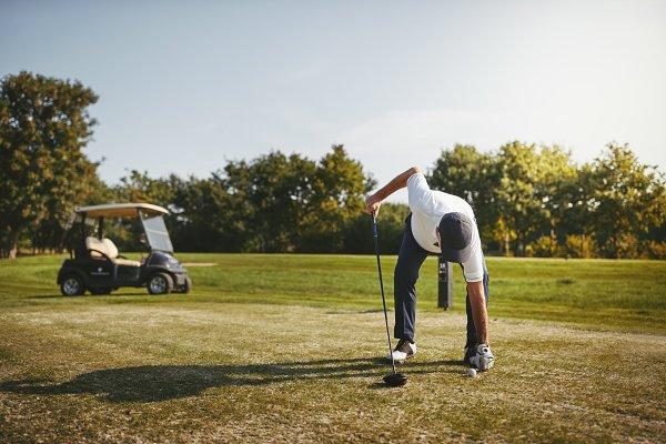 Senior man putting his ball on a go…