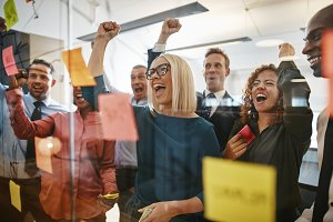 Businesspeople cheering while brains