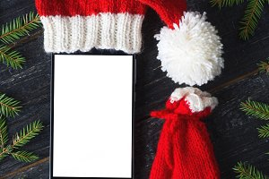 Empty smartphone in Santa's hat and