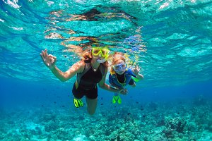 Mother, child showing divers sign OK