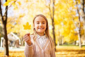 Image of happy girl in autumn forest