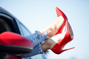 Image of girl's legs in red shoes
