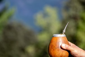 Man holding calabash yerba mate in