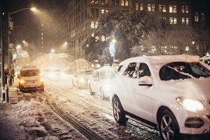 Night car traffic after snow storm