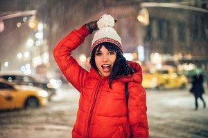 woman have fun in night winter city