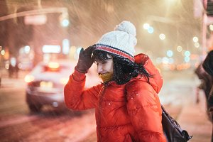 woman on city street winter snow
