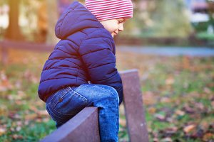 Funny child wearing hat and jacket