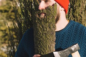 man with beard made of wood bark and