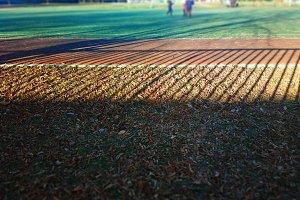 Diagonal dramatic fence shadows city