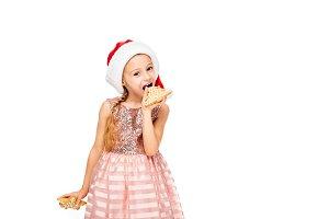 happy little child in santa hat eati