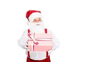 santa holding christmas present and