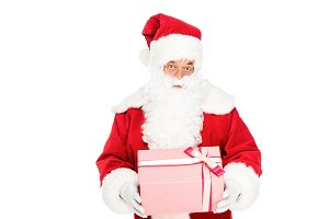 expressive santa claus holding gift