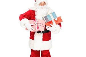 santa claus holding pile of gift box