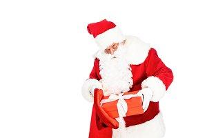 santa claus putting gift box into ba
