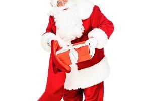 santa claus putting present into bag