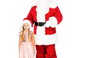santa claus and little child looking