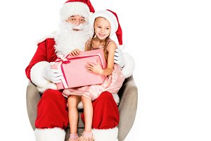 santa claus and little child sitting