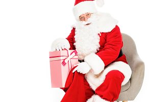 santa claus sitting in armchair with