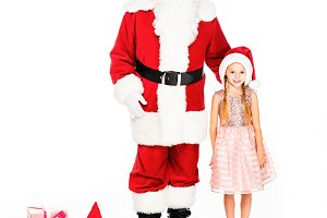 santa claus and little child with gi