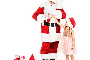 santa claus and little child with pi
