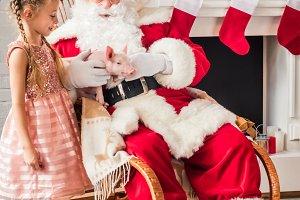 santa claus and cute little child pl