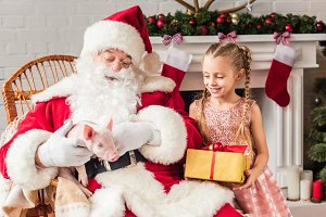 santa claus playing with pig and cut