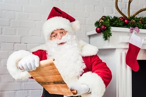 santa claus holding parchment and re