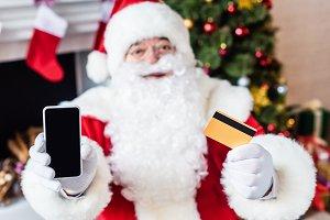 santa claus holding credit card and