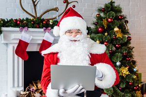 santa claus using laptop and looking