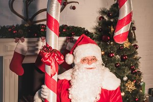 santa holding big candy cane and loo