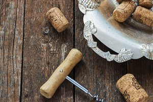 corkscrew and cork from wine on a wooden background