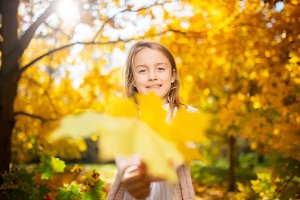 Photo of girl in autumn forest