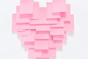 pink paper pieces in shape of heart