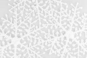 Snowflakes on white background on