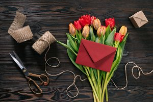 flat lay with bouquet of tulips, env
