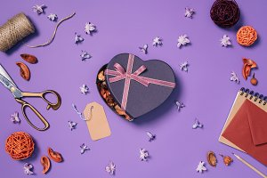 flat lay with heart shaped gift box,