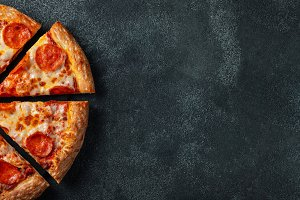Tasty pepperoni pizza and cooking in