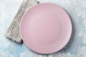 Pink empty plate and beige towel wit