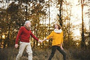 A senior couple on a walk in an