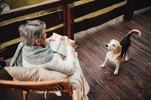 Elderly woman with a dog sitting