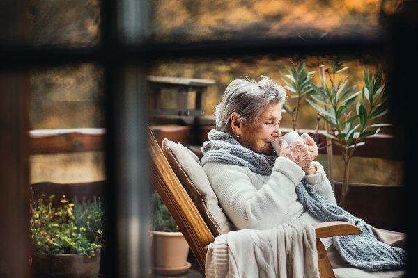 Stock Photos: HalfPoint - An elderly woman sitting outdoors on